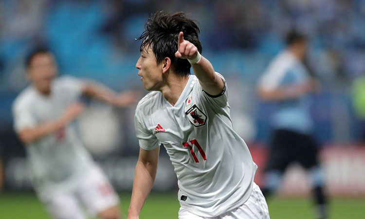 Miyoshi ghi cả hai bàn cho Nhật Bản vào lưới Uruguay. Ảnh: AFP.