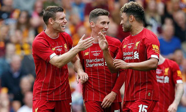 Milner (trái) tỏa sáng với cú đúp cho Liverpool. Ảnh: PA.