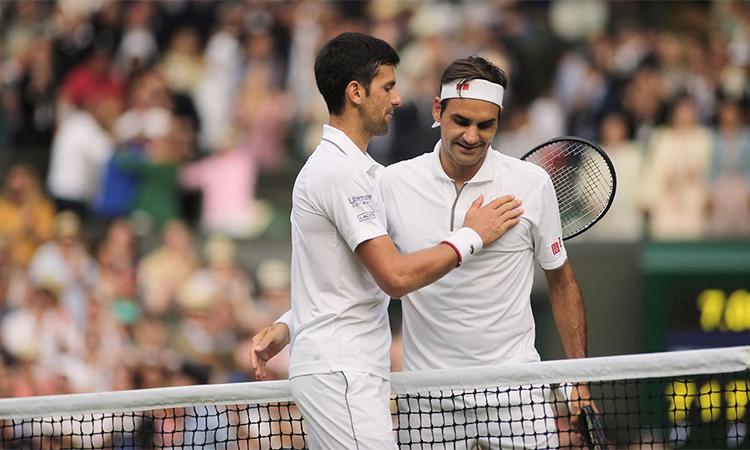 Federer (phải) lỡ cơ hội đoạt Grand Slam thứ 21. Ảnh: Wimbledon.