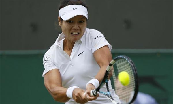 Li Na từng giành hai Grand Slam nhưng chưa từng đi quá tứ kết Wimbledon. Ảnh: Reuters.
