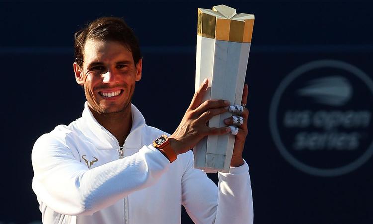 Nhờ chế độ tập luyện khắt khe, Nadal ở tuổi 33 vẫn vô địch bốn trong 11 Grand Slam gần nhất. Ảnh: Tennis.com.