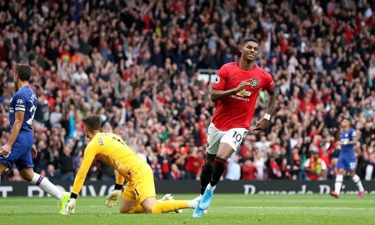 Rashford nâng tỷ số lên 3-0 cho Man Utd. Ảnh: PA.
