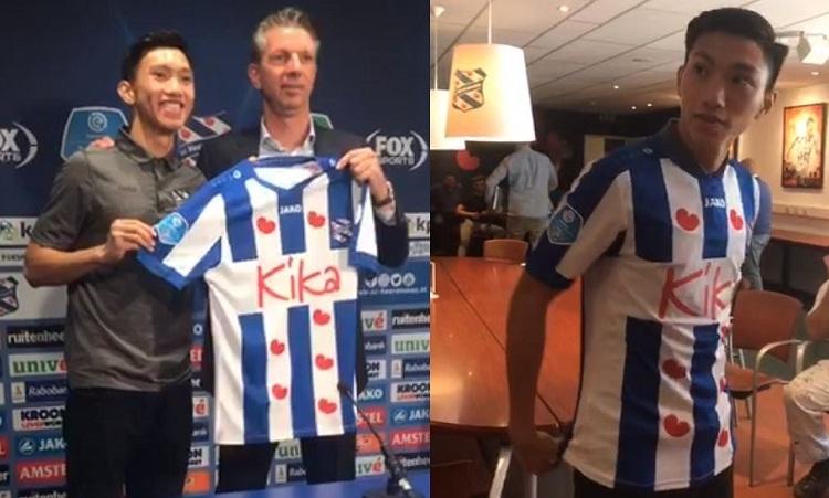 Văn Hậu mặc áo đấu của SC Heerenveen trong buổi họp báo ra mắt. Ảnh: SC Heerenveen.
