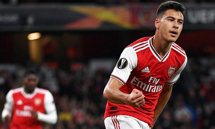 Martinelli mừng cú đúp trong vòng ba phút cho Arsenal. Ảnh: EPA.