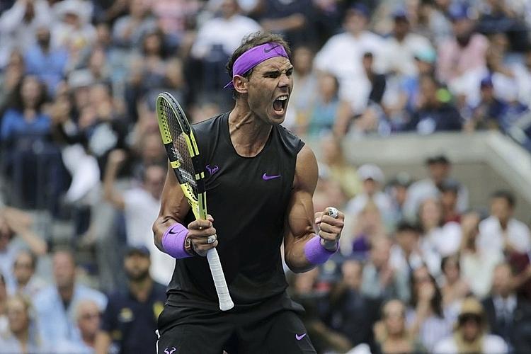 Nadal (ảnh) sở hữu 19 Grand Slam, kém Federer một danh hiệu lớn. Ảnh: AP.