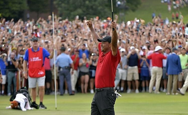 Woods mừng chức vô địch tại Tour Championship năm ngoái. Ảnh: AP.