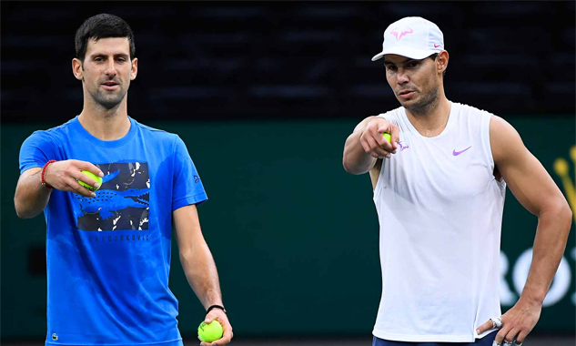 Djokovic và Nadal trên sân tập Paris Masters hôm thứ Bảy 26/10. Ảnh: FFT.
