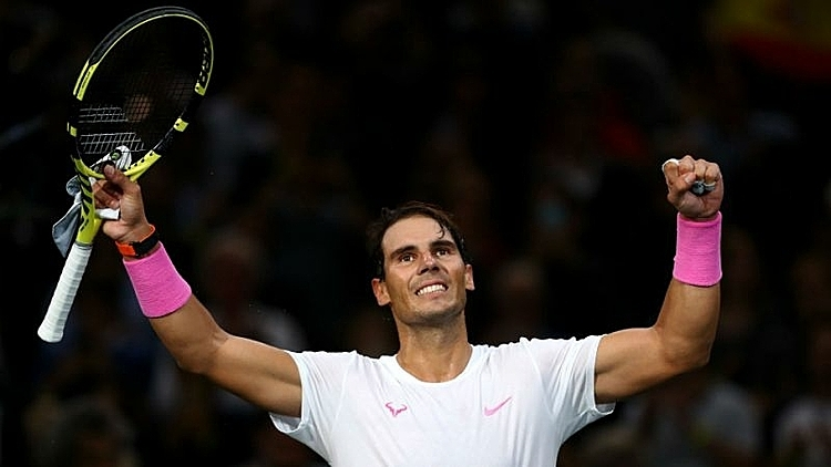 Nadal thắng trận đầu tiên sau hơn một tháng. Ảnh: Yahoo.