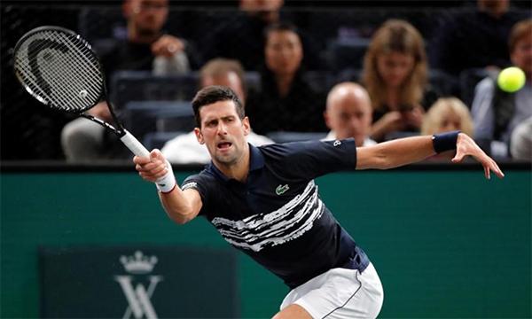 Djokovic mất tới 106 phút và nhiều lần thót tim mới có thể giành vé đi tiếp. Ảnh: Reuters.