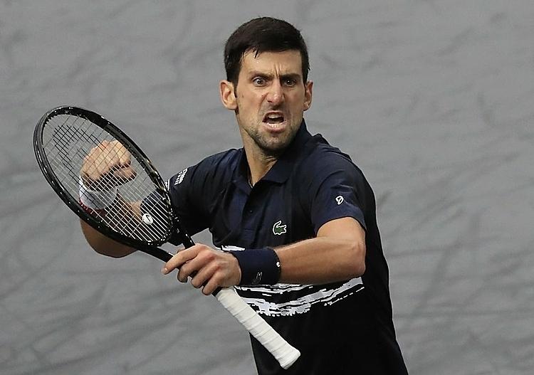 Djokovic mừng chiến thắng trong loạt tie-break set một. Ảnh: AP.