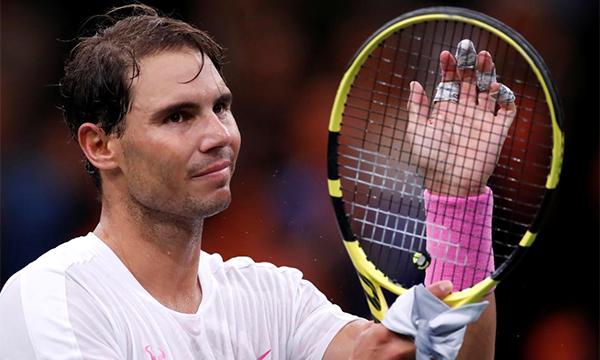 Nadal không muốn mạo hiểm với sức khoẻ trước thềm ATP Finals giữa tháng này, và quyết định dừng đánh trận bán kết Paris Masters hôm 2/11. Ảnh: Reuters.