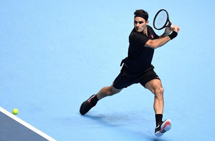 Federer đánh bại Berrettini sau một giờ 20 phút. Ảnh: Reuters.