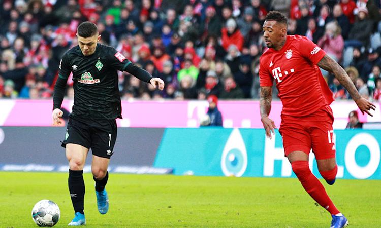 Rashica (trái) sút xa thành bàn mở tỷ số cho Bremen. Ảnh: FC Bayern.