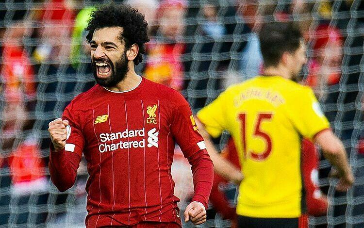 Salah mừng bàn mở tỷ số ở trận gặp Watford. Ảnh: REX.