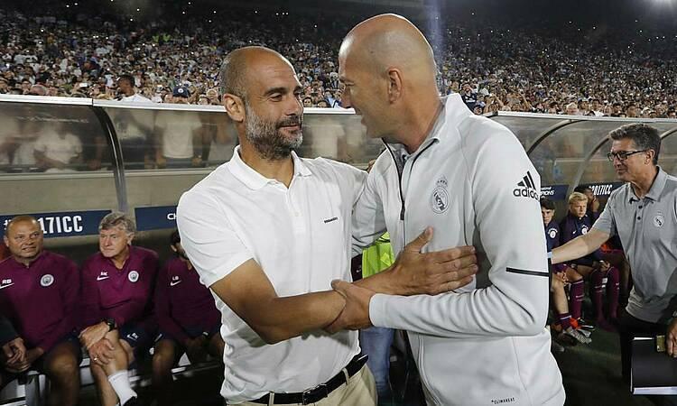 Guardiola (trái) và Zidane sẽlần đầu so tài ở một giải chính thức. Ảnh: AS.