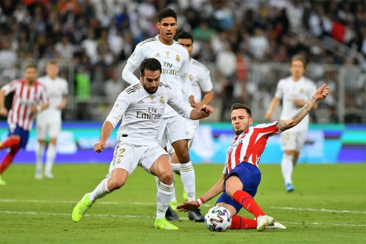 Real và Atletico chơi gần như ngang ngửa. Ảnh: Reuters