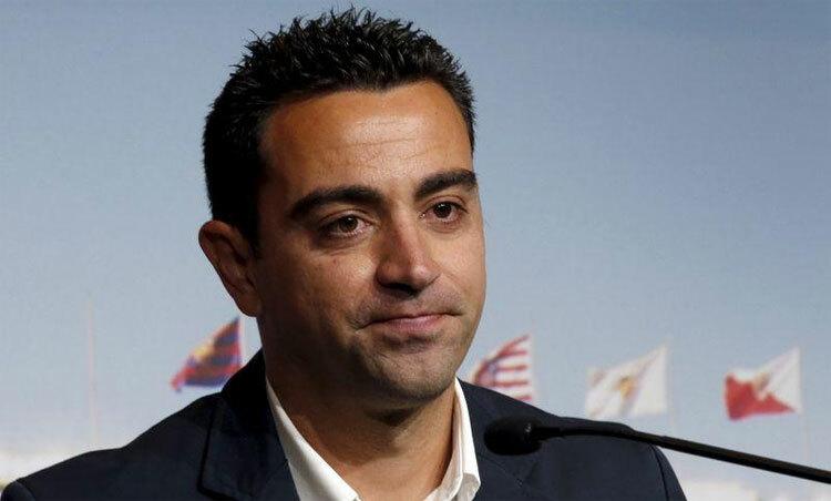 Xavi chỉ trở lại từ hè tới, nếu Barca đồng ý. Ảnh: Reuters