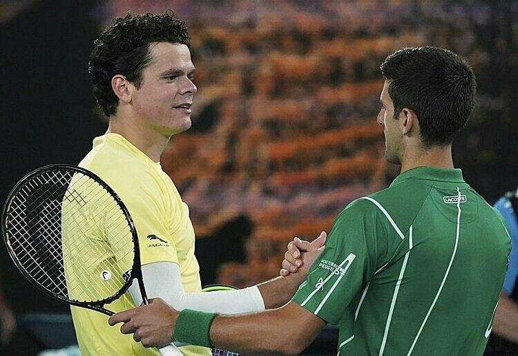 Djokovic (phải) toàn thắng cả 10 lần đối đầu với Raonic. Ảnh: AP.