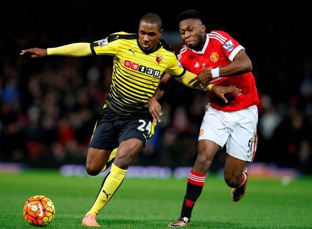Ighalo (áo vàng) thời còn cùng Watford chống lại Man Utd ở Ngoại hạng Anh. Ảnh: Reuters.