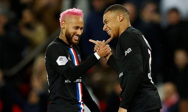 Neymar và Mbappe được xem là những đòn bẩy để PSG hiện thực hoá tham vọng chen chân vào hàng ngũ quyền lực ở bóng đá châu Âu. Ảnh: Reuters.