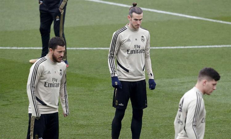 Hazard (trái) đang cần thêm cơ hội để chứng minh tài năng tại Real. Ảnh: AS.