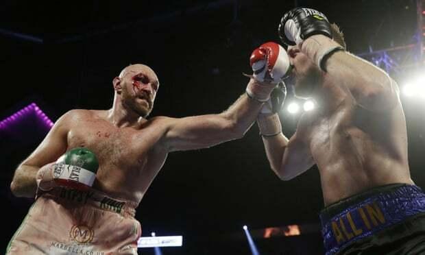 Ở trận gần nhất, Fury (trái) thắng Wallin nhờ tính điểm. Còn Wilder hạ knock-out Luis Ortiz ở hiệp bảy. Ảnh: AP.