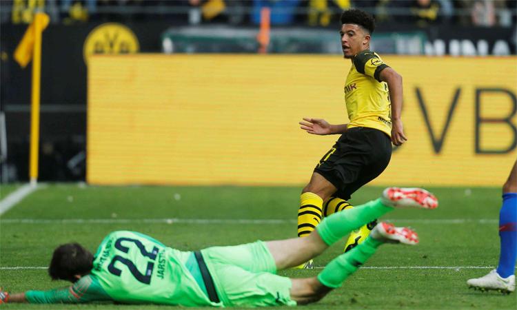 Sancho đang thăng hoa trên bệ phóng là chính sách trọng dụng, tin dùng các sao trẻ của Dortmund. Ảnh: Reuters.