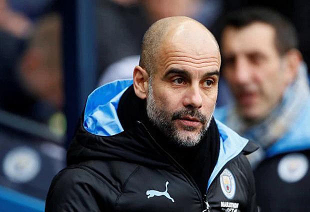 Pep Guardiola cam kết gắn bó với Man City. Ảnh: Reuters.