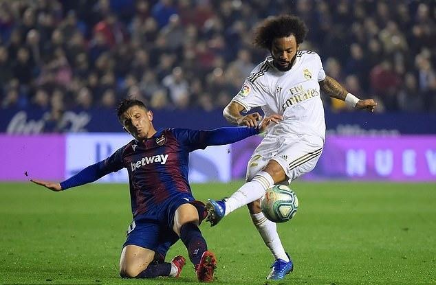 Marcelo là người chơi nổi bật nhất của Real, nhưng sự xuất sắc của một mình hậu vệ trái này không giúp đội khách có điểm. Ảnh: AFP.