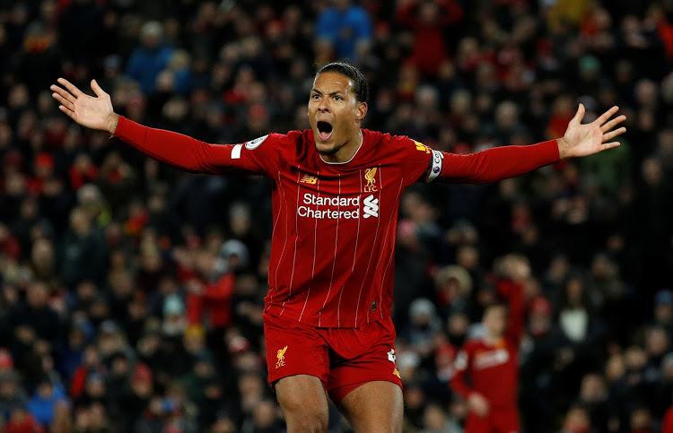 Van Dijk sắp có danh hiệu lớn thứ hai cùng Liverpool, sau chức vô địch Champions League mùa trước. Ảnh: Reuters.