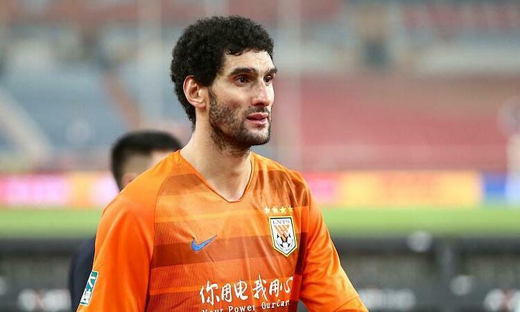 Fellaini dương tính với nCoV sau khi trở về Trung Quốc. Ảnh: Reuters.