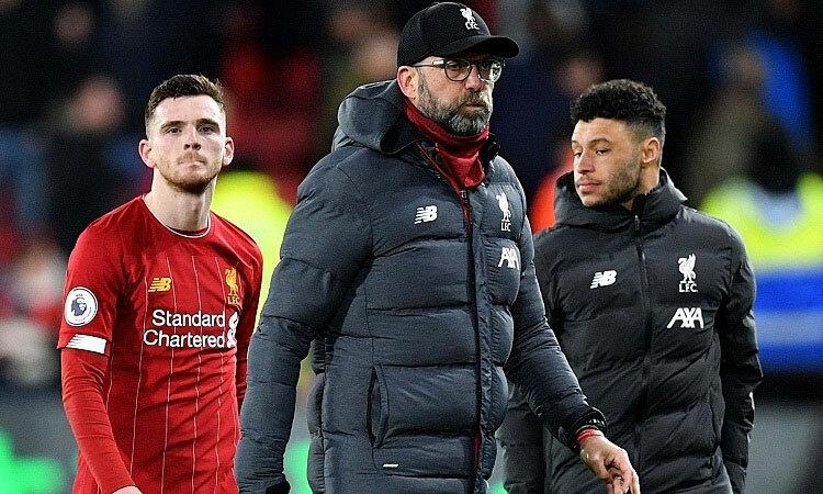 Liverpool có thể lỡ danh hiệu nếu dịch bệnh kéo dài. Ảnh: Reuters.
