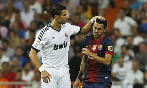 Pedro (phải) từng thách thức Ronaldo. Ảnh: AP.